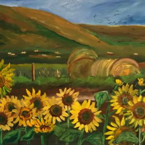oil painting of sunflowers in a field with hay and mountains by artist Caroline Karp