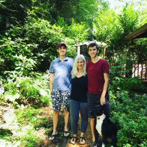 Artist Caroline Karp with her dog and boys