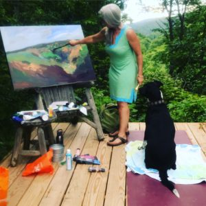 Artist Caroline Karp painting En Plein Aire with her dog Arya