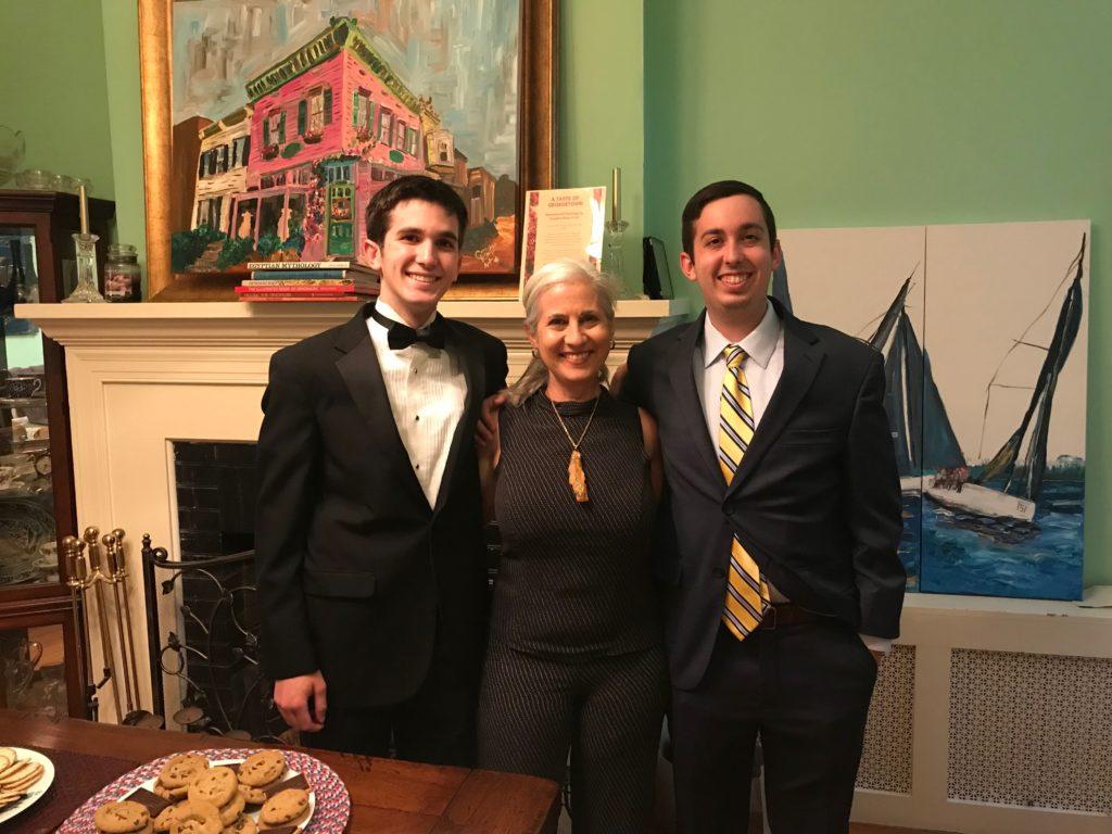 Caroline Karp Artist and her boys, Nicholai Babis and Sebastian Babis,  at her show art show in Georgetown, DC. Her paintings are in the background.