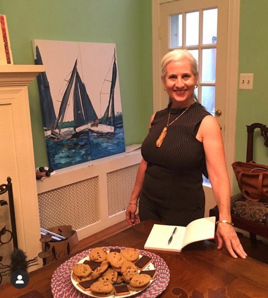 Caroline Karp Artist at her Georgetown, DC art show.