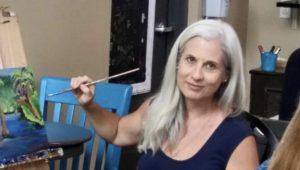 Artist Caroline Karp painting at Bamboozle in Tampa, Florida.