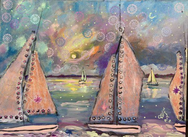 sailboats at sunset